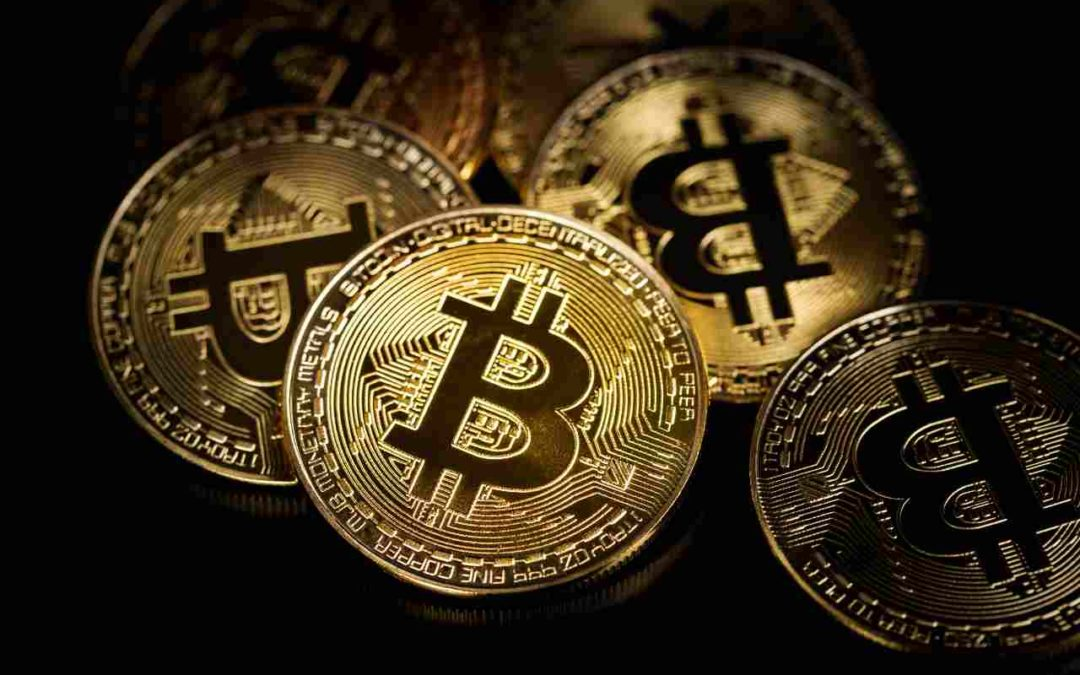 Golden bitcoins. Coin of cryptocurrency on black table.